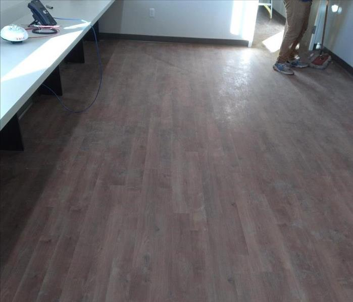image of commercial floor with winter elements making the floors appear dark and dirty